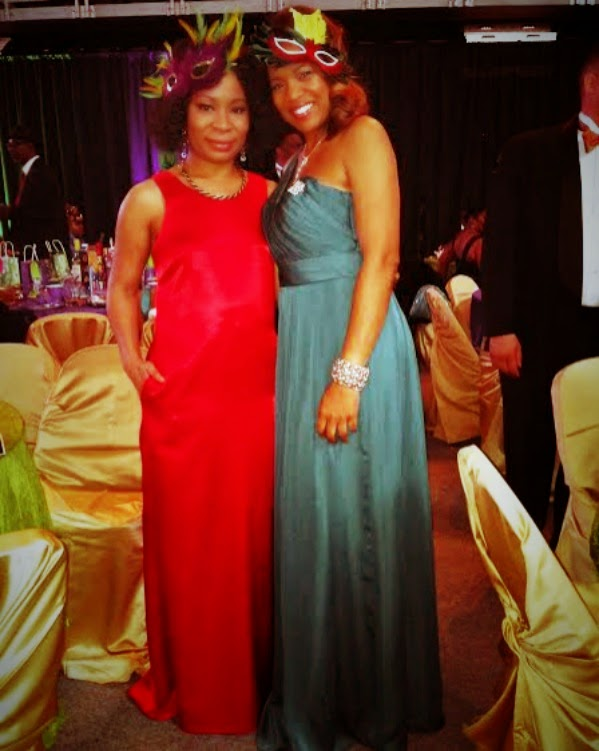 Chanel and Anita snap a photo at the Krewe of Athena Mardi Gras Ball