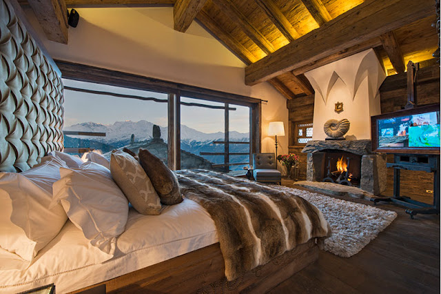 Picture of luxury gothic bedroom with fireplace and huge wooden bed