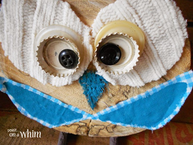 Bottle Caps, Buttons and Fabric Scrap Eyes on a Log Slice Owl via Denise on a Whim