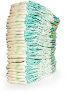 Some parents can't afford to work because they can't afford diapers. Stack of disposable diapers.