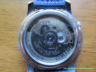 "Seiko SNK807 ""Seiko 5"" Automatic Men's Watch: Closeup Of Glass Case Back"