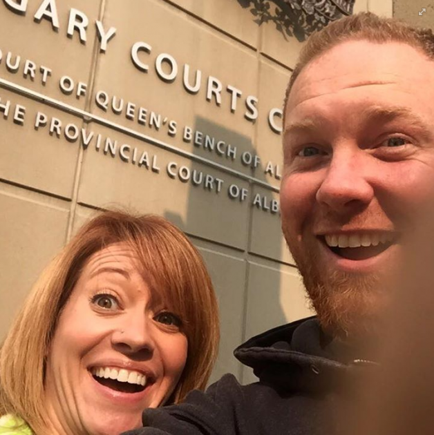 A divorcing Canadian couple, Chris and Shannon Neuman, have gone viral with their smiling selfie.  The photo, which was taken outside a court in Calgary, soon after filing for divorce, shows them smiling joyfully into the camera.