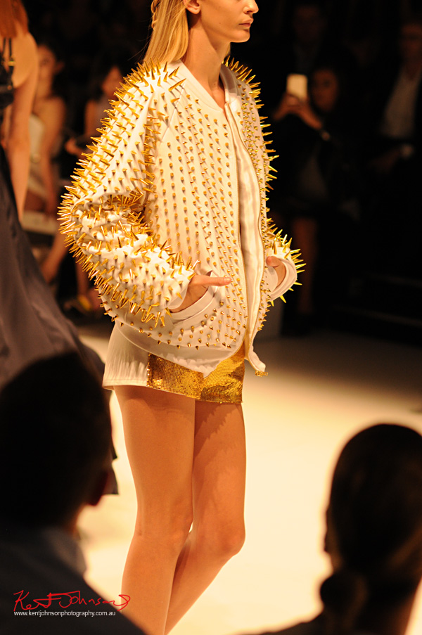 White leather jacket with gold pointed studs, white short gold-lamé with front. ANY STEP by Amy Le and Stephanie McGuigan - MBFWA - Photographed by Kent Johnson.