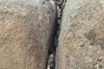 Saat Berwisata, Wanita Ini Terjebak di Celah Batu