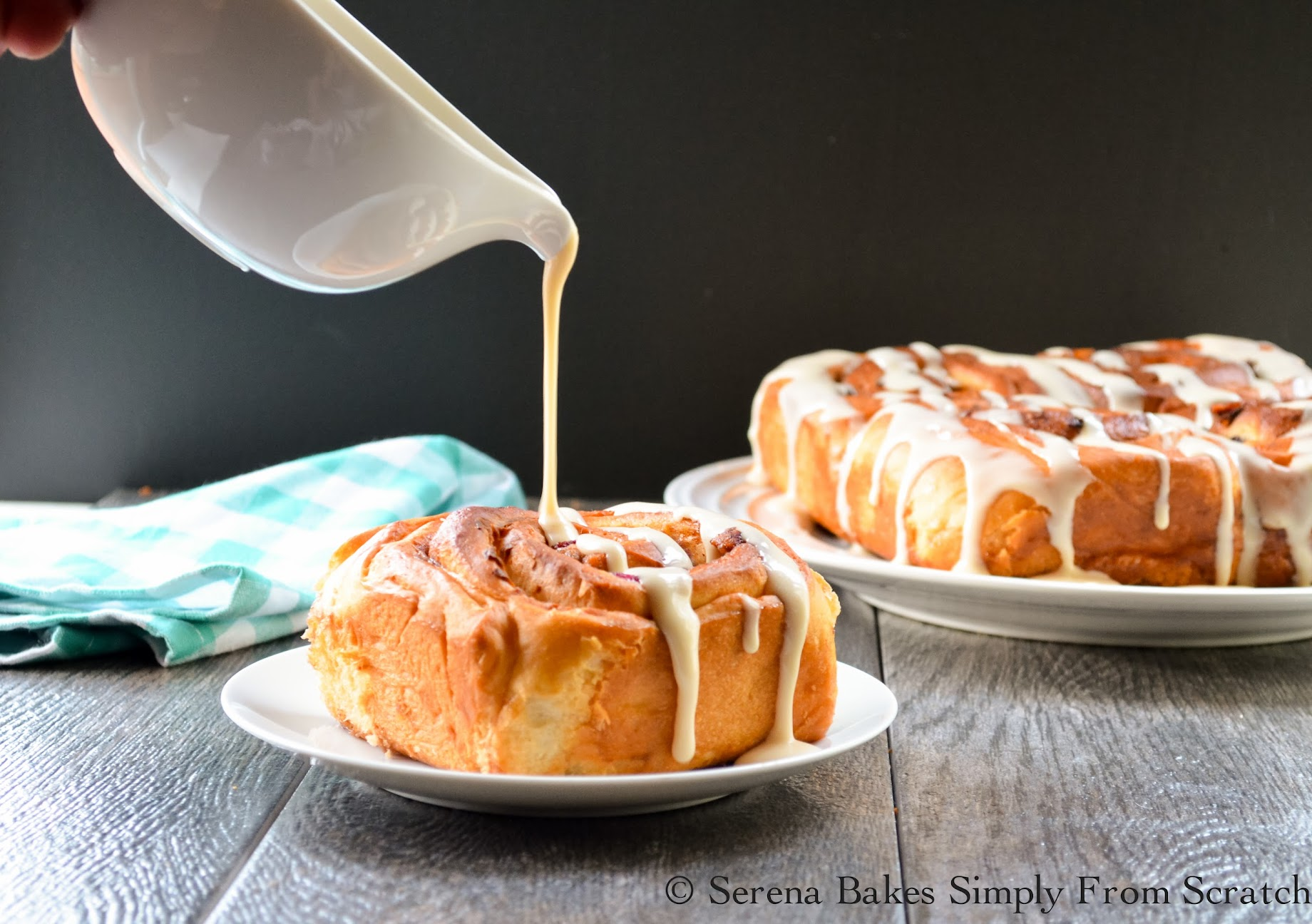 Bacon Blueberry Cinnamon Rolls drizzled with maple icing.