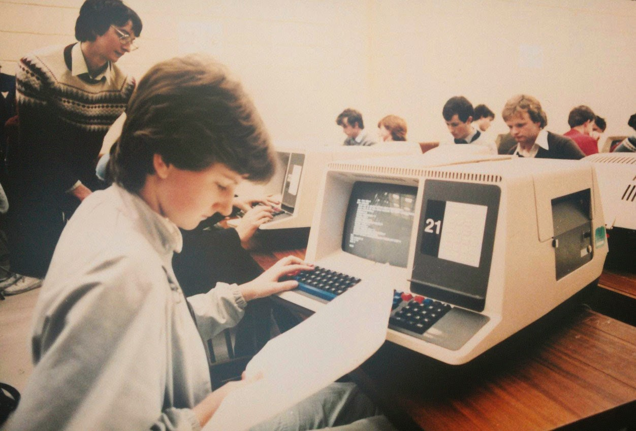 very old picture of a boy coding a webpage