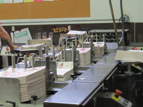 newspaper stuffing machine