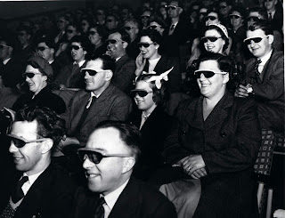 "Audience wearing special glasses watch a 3D ""stereoscopic film"" at the Telekinema on the South Bank in London during the Festival of Britain"