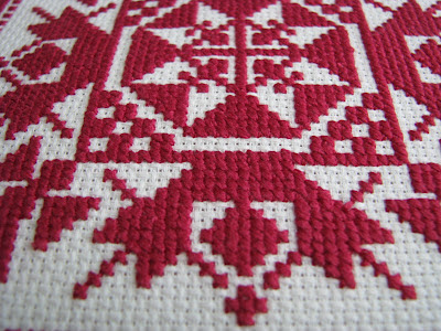 traditional ornament geometrical cross stitch pillow red