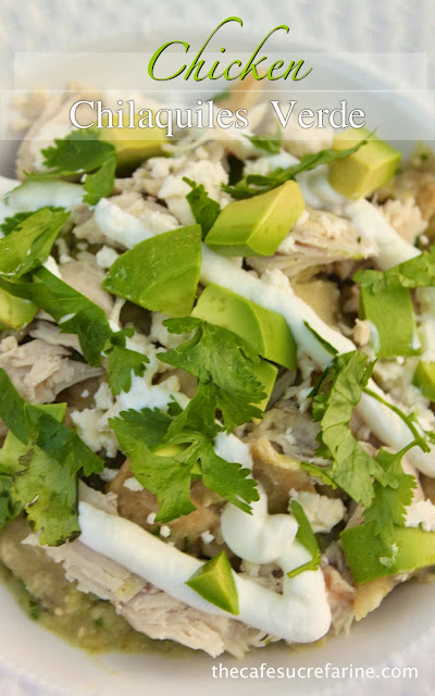A closeup photo of a white dinner plate of Chicken Chilaquiles Verde.