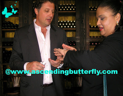 Prince Scipione 'Skip' Borghese applies the Perlier Lemon Sorbet Refreshing Ice Granita to Ascending Butterfly's hand