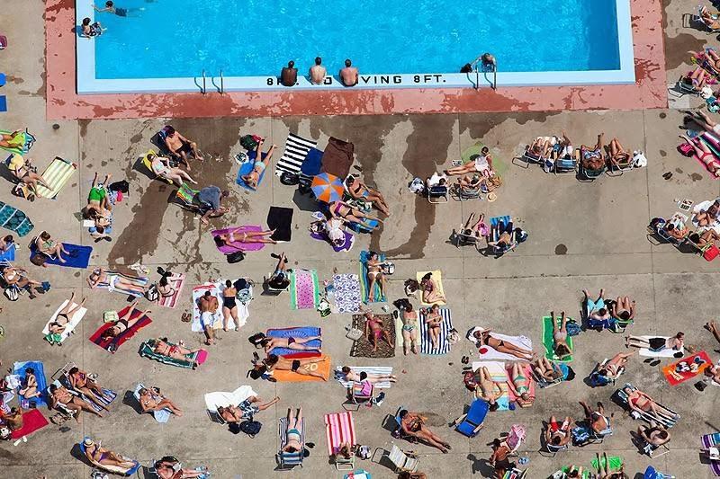 Sunbathe poolside, Cambridge, Massachusetts, USA.
