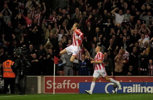 Peter Crouch celebrates with Stoke team-mate Jon Walters after scoring against Manchester City