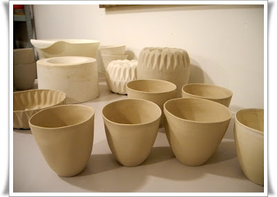organic shaped cups made of slip cast porcelain