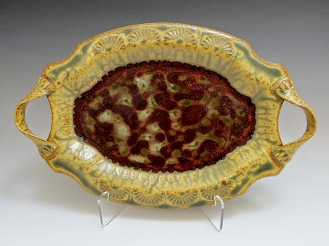 http://www.carolinacreationsnewbern.com/NewFiles/Ray-Pottery.php