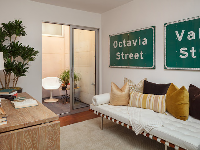 Picture of small contemporary room with road signs on the wall