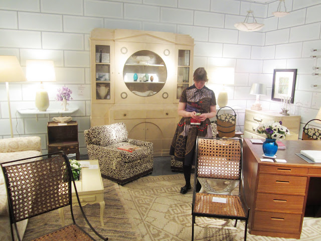 Liz O'brien booth filled with vintage mid century classic furniture