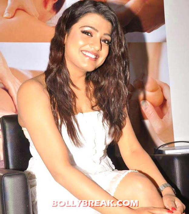 Tashu kaushik sitting  - Tashu Kaushik in white strapless dress