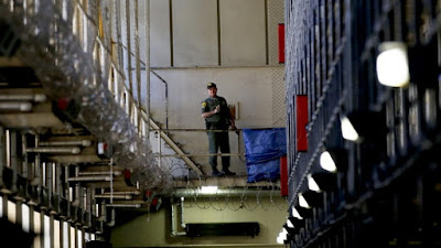 A guard stands watch over the condemned prisoners housed in East Block during a media tour of death row at San Quentin prison.