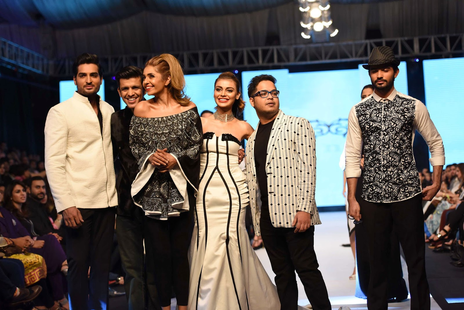 deepak and fahad at the end of the show with the models