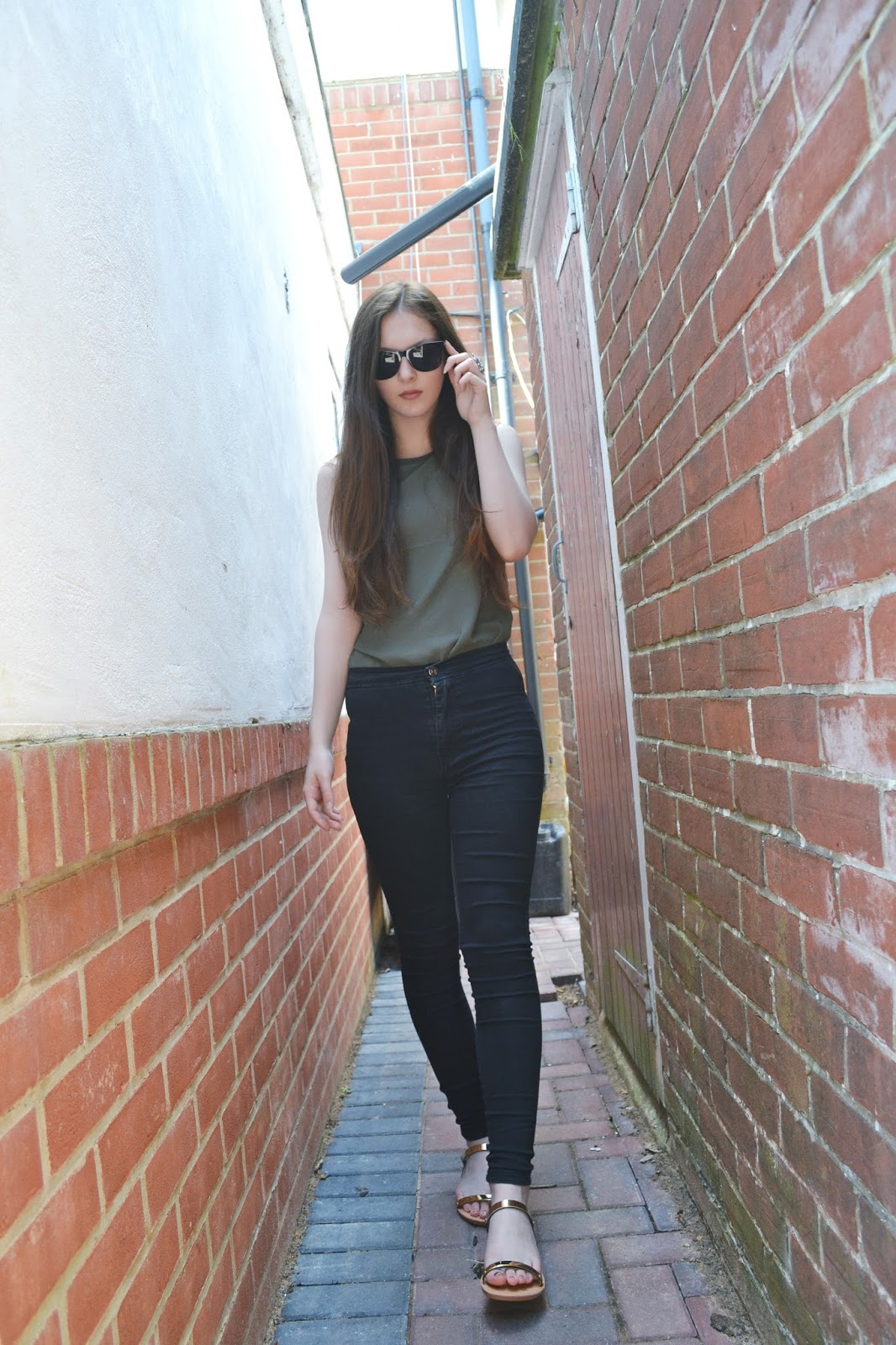 khaki top black jeans sandals