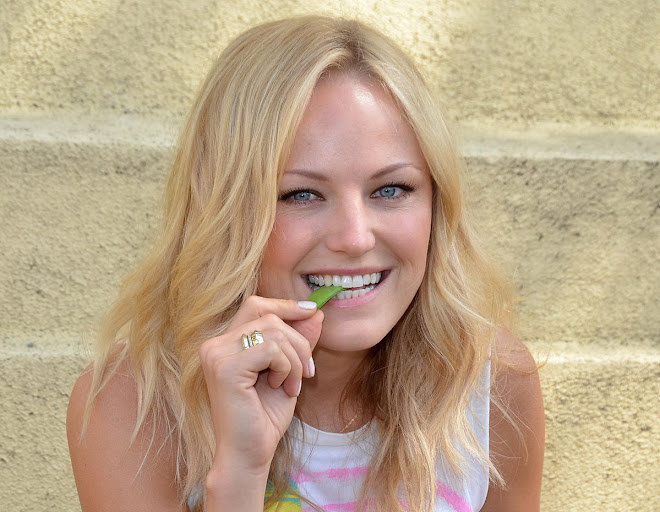 Malin Akerman eating ang planting seeds in Los Angeles