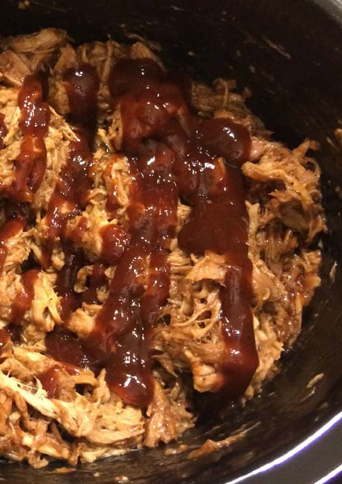 Shredded Root Beer Pulled Pork with added BBQ Sauce for a lil bit more slow cooking