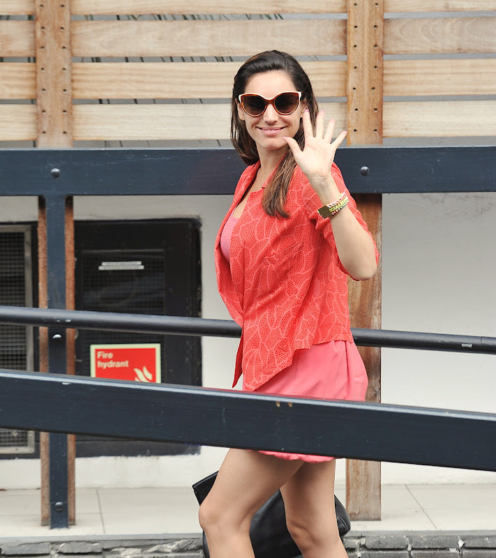 Kelly Brook waved at cameras on her way to London Studios