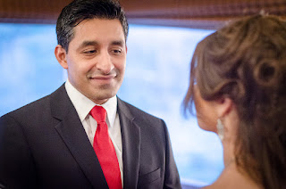 Christian looks at Katie during their wedding ceremony officiated by Patricia Stimac, Seattle Wedding Officiant