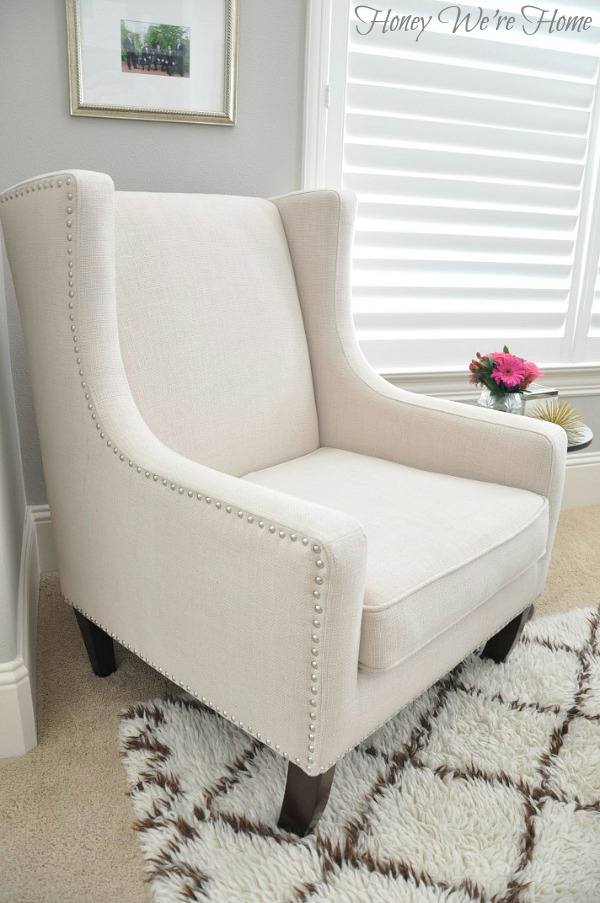 Love the nailhead trim on this wingchair