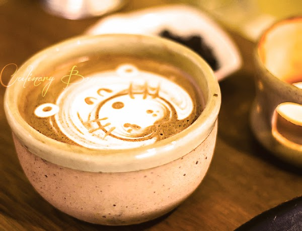 A cute smiling chubby hippo latte art