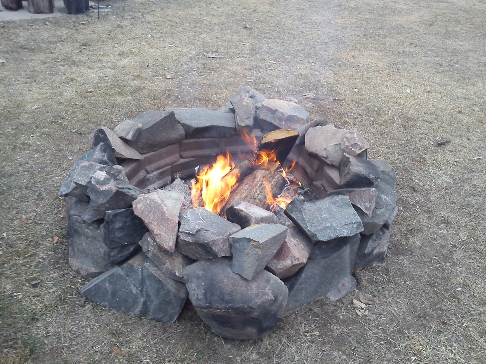 The handy woman jill of all trades diy how to build a for Backyard rock fire pit ideas