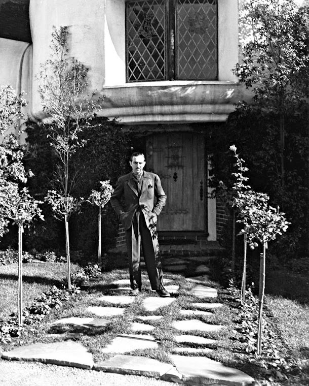 Walt Disney at the front of his home.