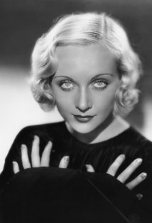 Vintage black and white photo of Carole Lombard in a black outfit.