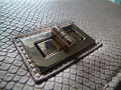 Nude snakeskin clutch