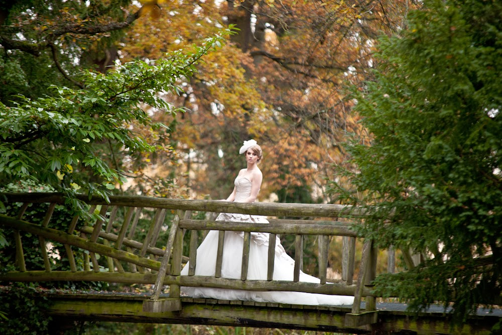 Vintage wedding styled shoot with bride on the bridge at Manor by the Lake