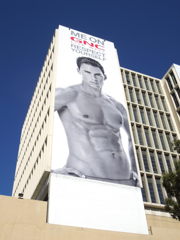 Giant GNC Live Well male model billboard