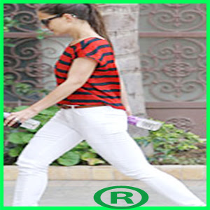 Katie Holmes wearing white jeans