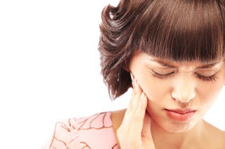 Woman with Toothache - How does a Bedbound M.E. patient get to a dentist?