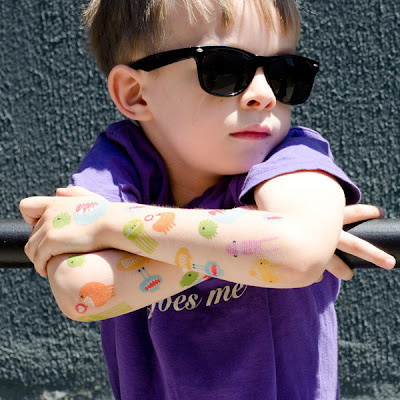 young boy with monster-themed temporary tattoos