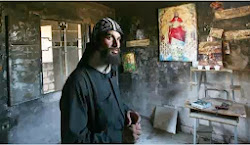 Egyptian priest checking his burned church