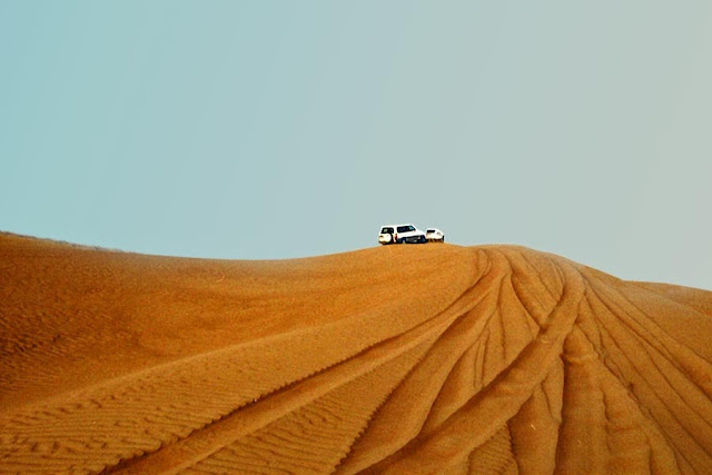 tourist jeep on the sand dunes in dubai