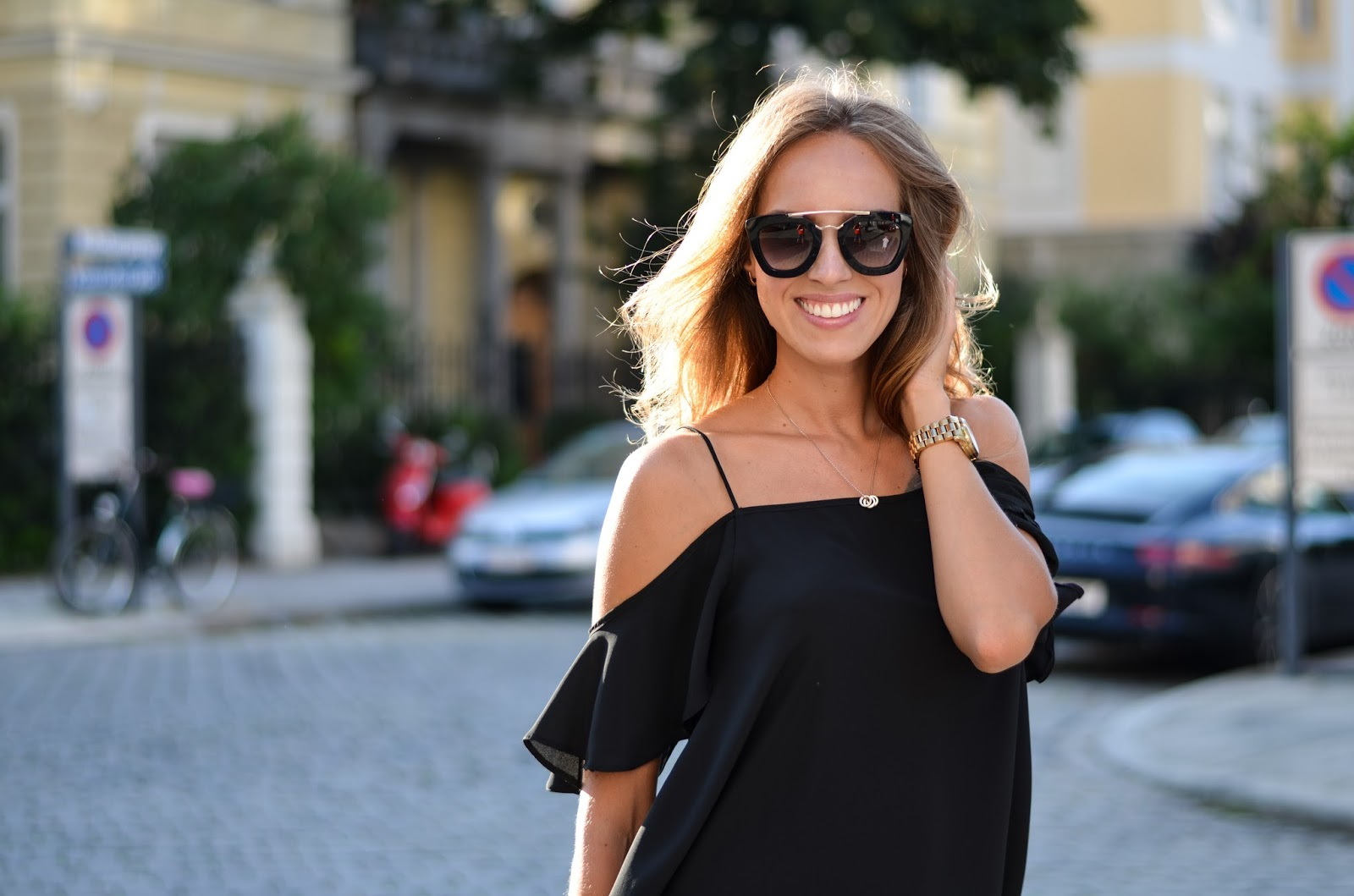 kristjaana mere black asos off the shoulder top