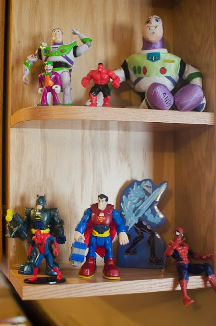 superheros on shelf