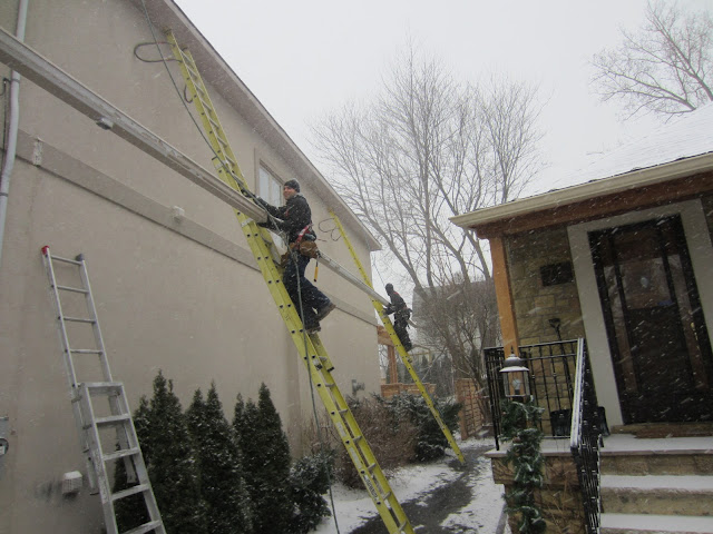 Safety eavestrough installation gutter tied off WSIB Winter Toronto