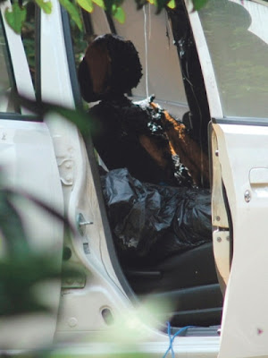 Mayat wanita ditemui dibungkus dengan plastik hitam dalam kereta.