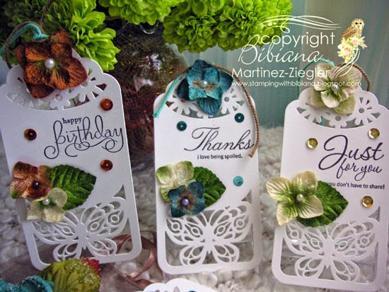 3 gift tags made with petaloo flowers