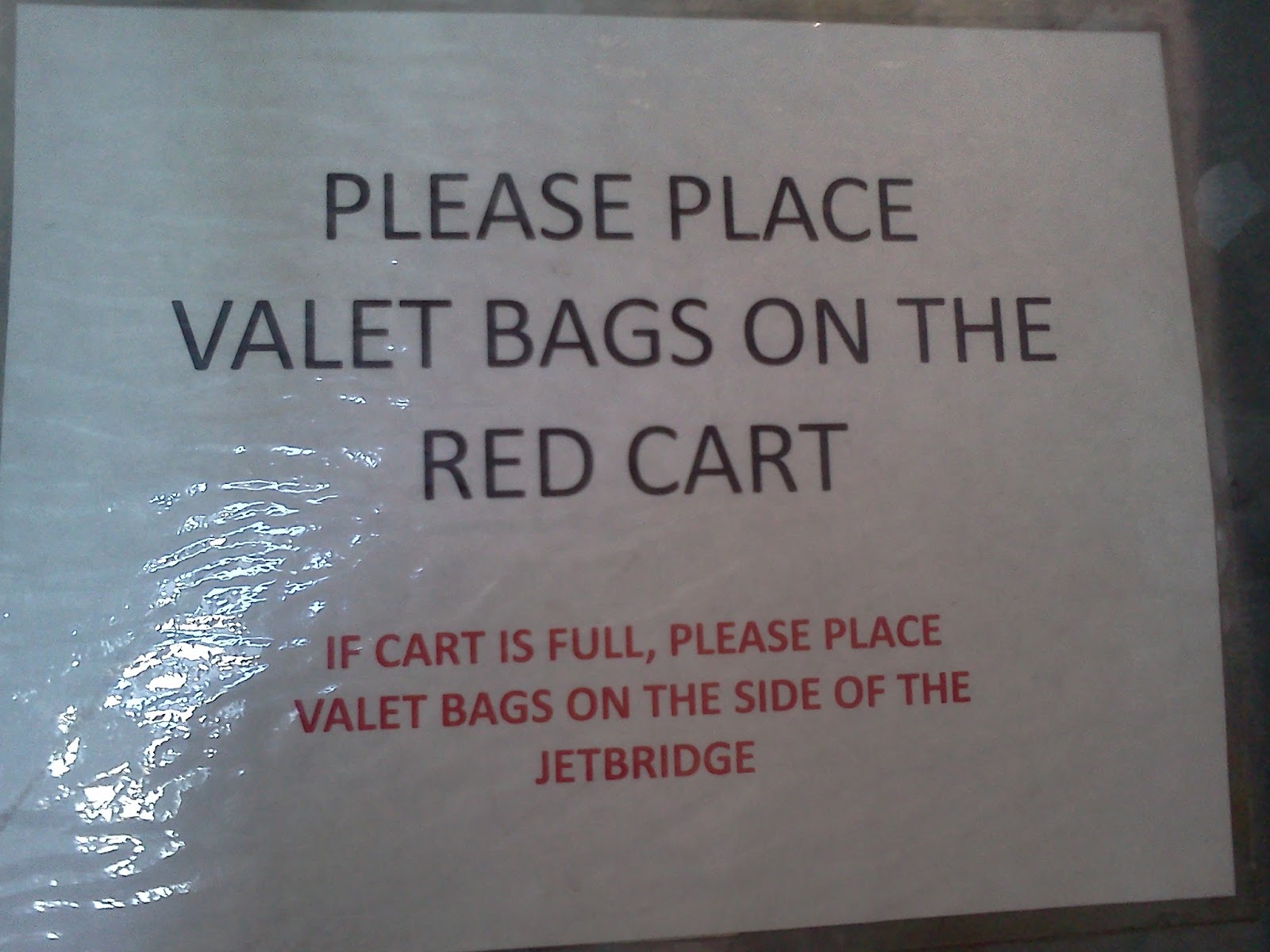 Please Place Valet Bags On The Red Cart
