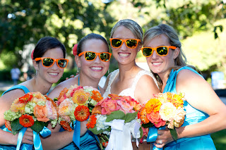 Bridesmaids with bouquets and Jillian, all with orange sunglasses
