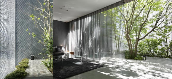 The First Floor Of The Optical Glass House Is Occupied By A Garden And A Glass  Façade Positioned Towards The Street That Maximizes Natural Lighting.